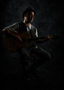 JT+acoustic sat in the dark